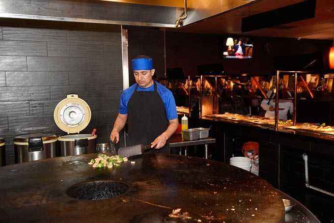 Christopher Lopez cooks Mongolian BBQ at Fuze, Monday, April 4, 2016. - GARETT FISBECK