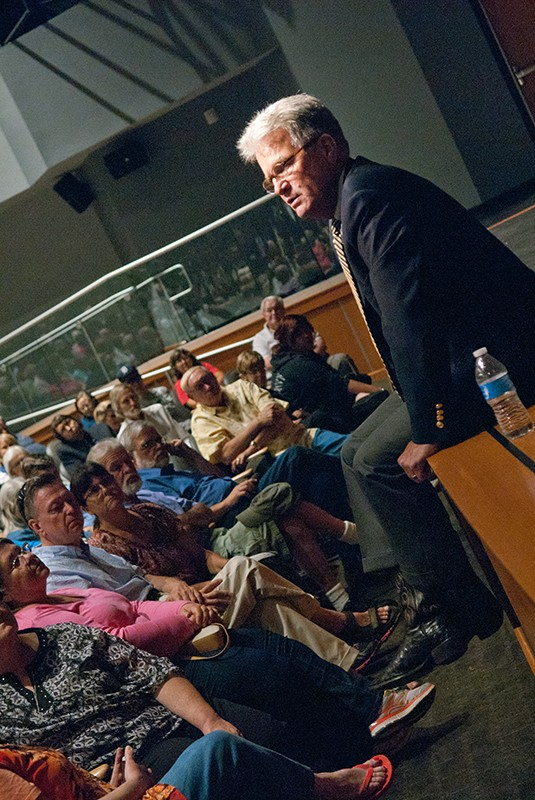 U.S. Senator Tom Coburn gets comfortable at the edge of the stage during a town hall meeting in the OCCC Visual and Performing Arts Center, Monday, 8-4-14.  mh