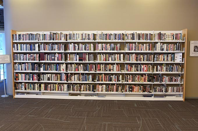 A bookshelf in the Ronald J. Norick Downtown Library.  mh