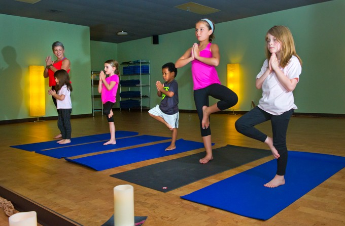 Denise Springer teaches a children's yoga class at You Power Yoga in Edmond.Photo/Shannon Cornman - SHANNON CORNMAN