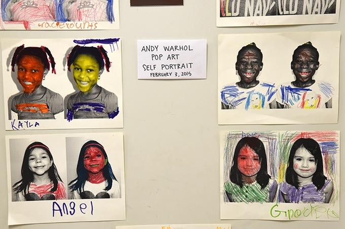 Pop art self portraits of students, displayed in the hallway at Possitive Tomorrows school.  mh
