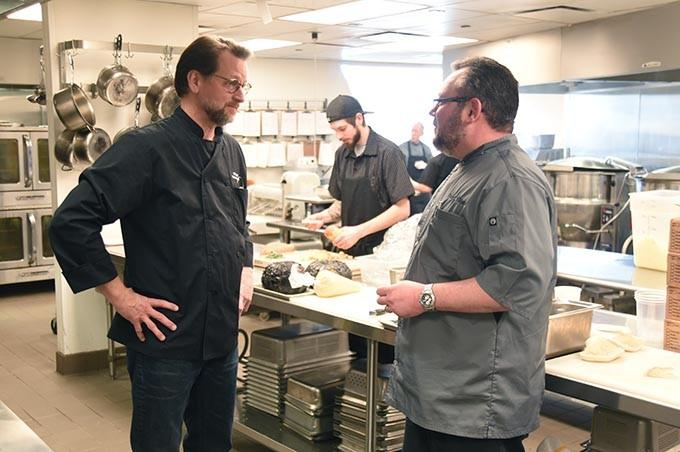 Restaurant Director Kirt Fleischfresser, left, discusses the evening dinner with Exec. Chef Patrick Williams, in the Vast kitchen recently.  mh