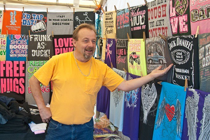 Charles Bennett helps run the t-shirt booth at the State Fair. (Mark Hancock)