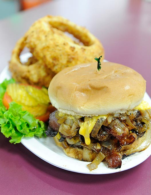 Grilled Onion Cheeseburger and onion rings in Oklahoma City, Thursday, Nov. 12, 2015. - GARETT FISBECK