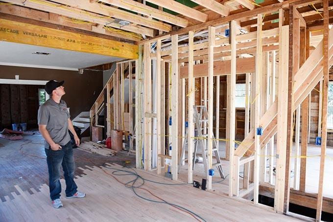 Brandon Swearingen looks at a historic home he is restoring in Oklahoma City, Thursday, March 17, 2016. - GARETT FISBECK