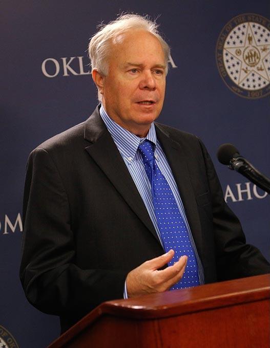 Mark Hammons, State Democratic Party Chairman, speaks at the Oklahoma State Capitol in Oklahoma City, Monday, Nov. 16, 2015. - GARETT FISBECK