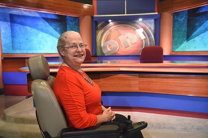 """Pam Henry, in front of the anchor desk for the Oklahoma News Report, where they did at least one interview for her documentary """"The Last Poster Child"""", at OETA.  mh"""