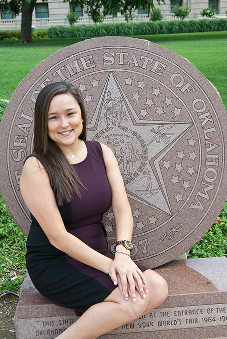 Oklahoma House District 85 candidate Cyndi Munson poses on the State Seal monument in front of the State Capitol.  mh