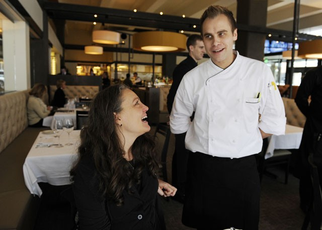 Jeff Dixon, Broadway 10 Bar & Chophouse co-owner, speaks with Terri Sadler of Fitzsimmons Architects, at the restaurant. (Garett Fisbeck)