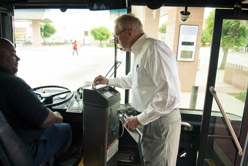 Book in hand, OKC Ward 5 Councilman, David Greenwell boards bus #16 driven by Anthony Sistrunk, at the downtown Metro Transit terminal, just blocks from his work.  mh