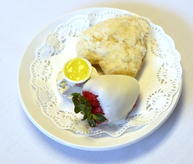 Dipped Strawberry with heard shapped scone and lemon curd, served next to the Bacon-Pinach Quiche dish.  mh