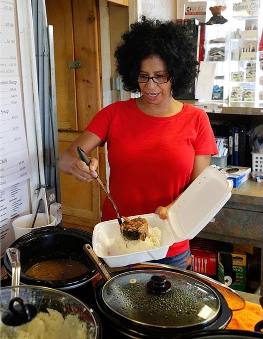 Carmen Singleton makes up a pot roast dinner at the Shell Station in Oklahoma City, Wednesday, Aug. 19, 2015. - GARETT FISBECK