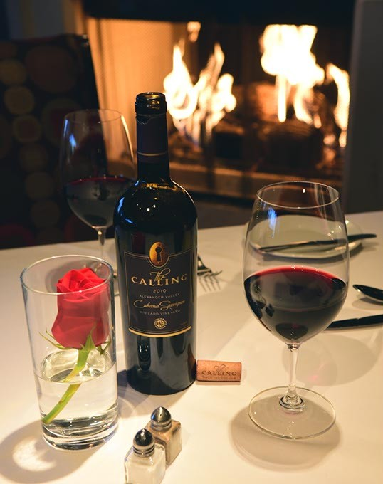 The Calling Cabernet Sauvignon by the fire at The Coach House, 6347 Avondale Drive.