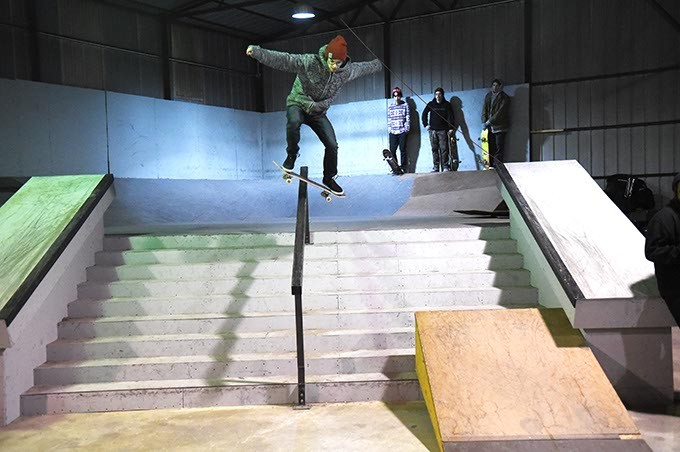 A skateboarder rides down a railing, inside the Industrial Skateboard Park, just south of Downtown Oklahoma City, 1-18-16. - MARK HANCOCK