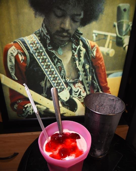 Strawberry milkshake in front of Jimi Hendrix photo, at Fat Elvus Diner in Yukon.  mh