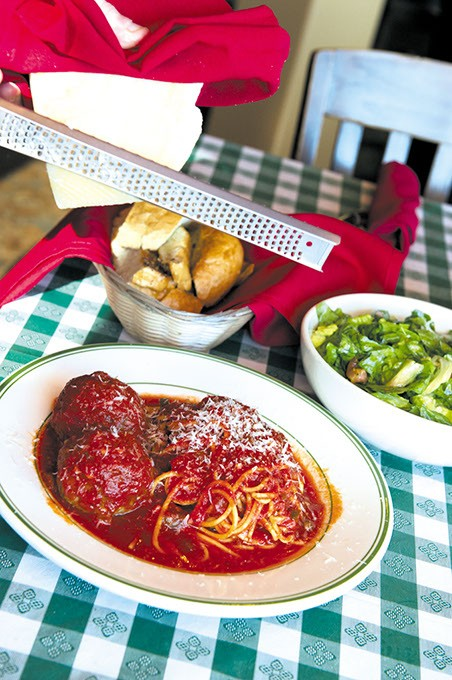 Spaghetti with meatballs and fresh parmesan cheese, salad and garlic bread hot out of the oven at Gabriellas.Photo/Shannon Cornman - SHANNON CORNMAN