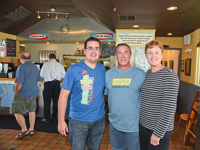 Mutts has new owners, from left, Eathan Barfield, with Kevin and Laurel Wilkerson.  mh