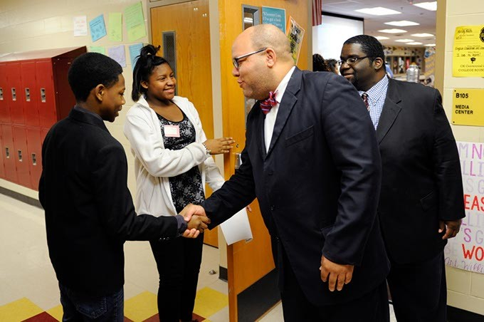 Rep. Mike Shelton shakes hands with student Jemi Thompson during a tour at Centennial High School in Oklahoma City, Wednesday, Jan. 28, 2015. - GARETT FISBECK
