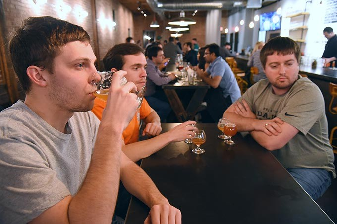 From left Kyle Pierce, Zack Martin and Andy Rothfusz socialize and watch Thunder basketball at Oak & Ore in the Plaza District. (Mark Hancock)