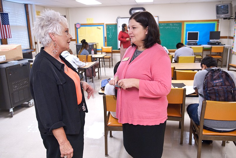 Aurora Lora, right, meets with Emerson Alternative School's principal, Sherry Kishore, in one of the classrooms.  mh