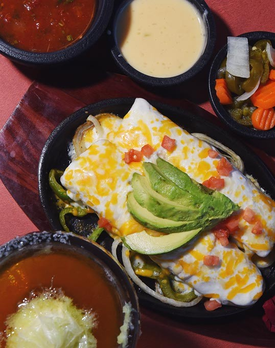 Tacate, sauces and Avocado Enchiladas at Wholly Guacamole Kitchen in Midwest City.  mh