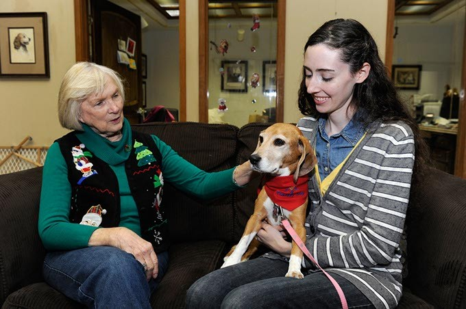 Barbara Lewis, director, and Elizabeth Maupin, pose for a photo with Snapple, a therapy dog, at New Leash on Life in Oklahoma City, Friday, Dec. 5, 2014. - GARETT FISBECK