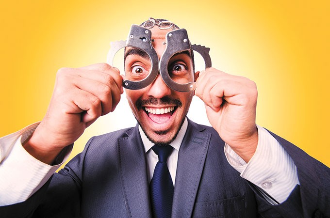 Funny businessman with handcuffs on white - BIGSTOCK