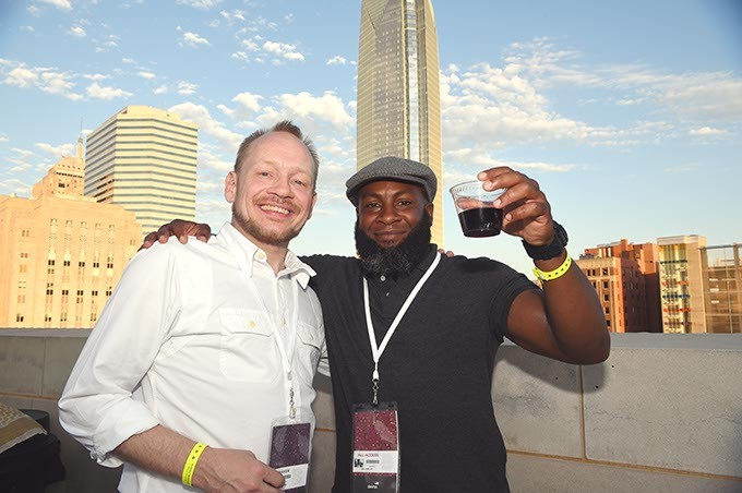 From left, Peter Gibbons and Ian Lawlar, attending the OKCMOA opening night rooftop party for the DeadCenter Film Festival, 6-11-2015.  Mark Hancock