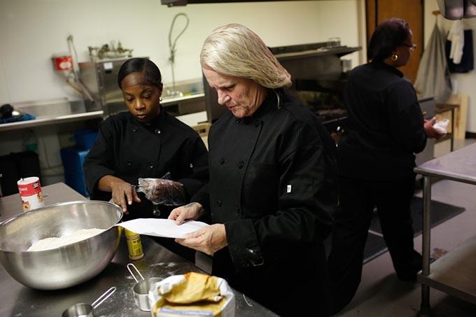 Myra Brooks, Tina McAtee, and Shelia Jackson work in a kitchen at TEEM in Oklahoma City, Thursday, Oct. 15, 2015. - GARETT FISBECK