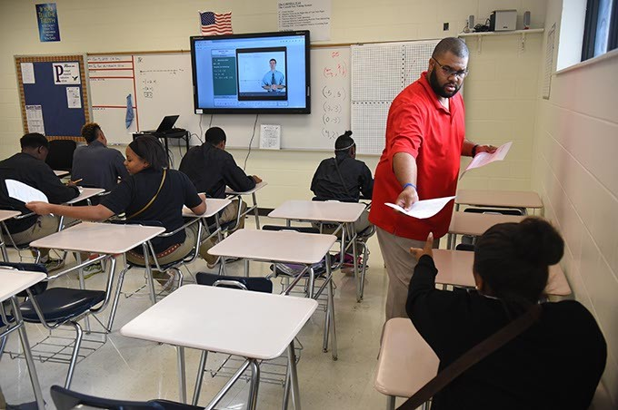 Coach and math teacher, Darwin Franklin, hands gives a test to his algebra 1 students, 10-5-15, at Millwood High School. - MARK HANCOCK