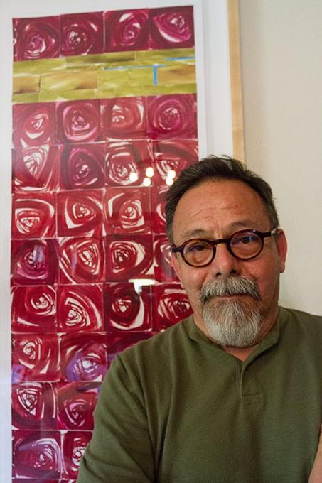Paul Medina standing in front of his artwork at his home in OKlahoma City, Oklahoma, Thursday, june 25, 2015. - KEATON DRAPER