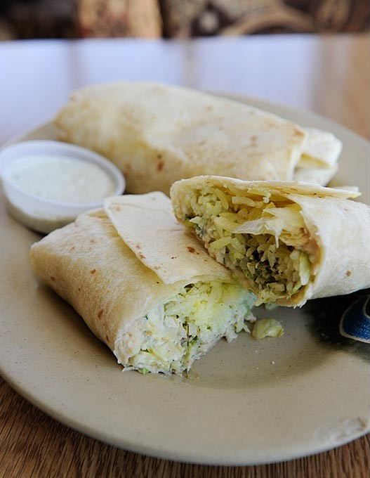 Falafel Burrito at Couscous Cafe in Oklahoma City, Wednesday, March 11, 2015. - GARETT FISBECK
