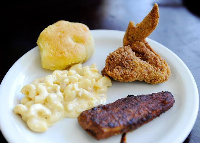 Fried chicken, macaroni and cheese, blackened catfish, cornbread roll, at Cajun King in Oklahoma City, Monday, Dec. 14, 2015. - GARETT FISBECK