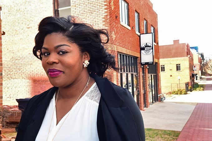 Ashley Stevenson owner of Foodie Foot Tours, outside Urban Roots and across from Deep Deuce Grill, in Deep Deuce which will be an up-comming destination for her foot tours.  File photo from 1-20-15 - MARK HANCOCK