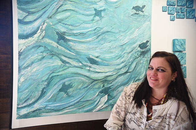 "Chickasaw artist Cale Chadwick with her work ""Ouzels Flying Through Water"", with more of her work currently at Exhibit C.  mh"
