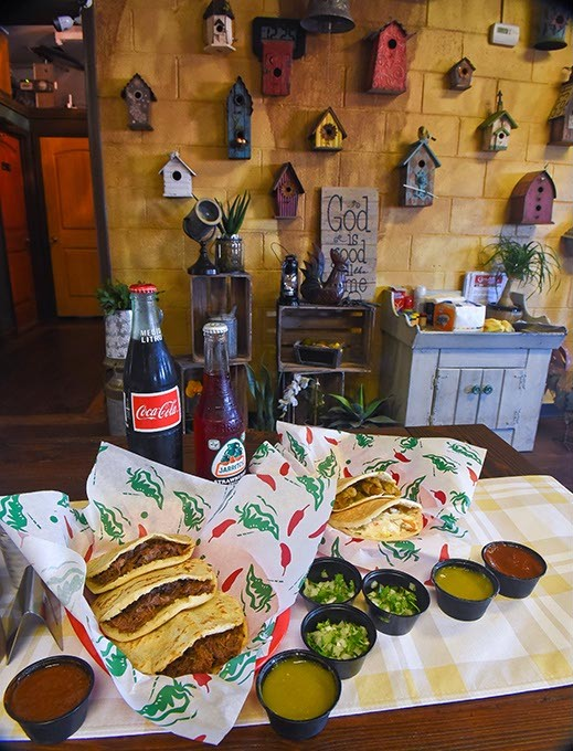 click to enlarge an assortment of pork crackling chicken with cream and beef barbacoa gorditas with - Mexican Kitchen