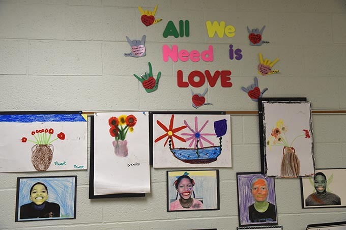 Student artwork displayed in the hallway at Possitive Tomorrows school.  mh
