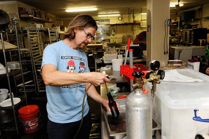 Jared Toay bottles a probiotic soda at Urban Agrarian in Oklahoma City, Thursday, Oct. 22, 2015. - GARETT FISBECK