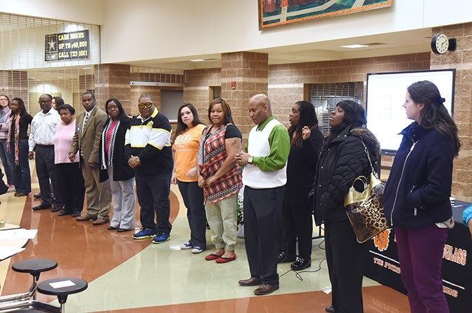 "People participate in an exercise to illustrate ""Students left behind"" while attending The Great Conversation public meeting held at Fredrick A. Douglass High School, Monday, 3-2-15.  mh"