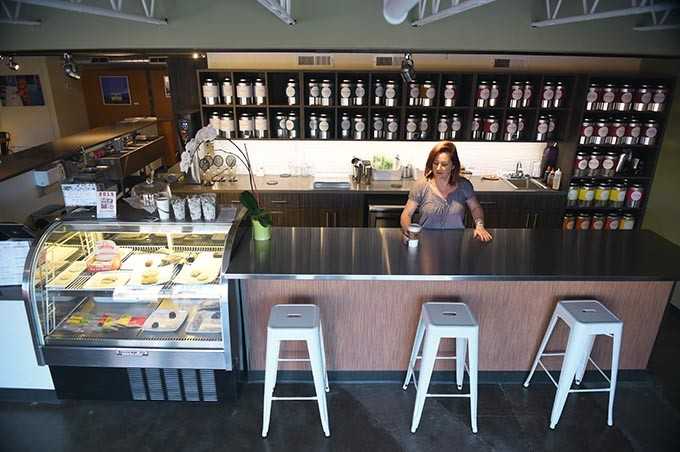 Owner Kristy Jennings places a fresh tea on the front counter of her spacious new t Urban Teahouse location, 519 N.W. 23rd. Street, on the backside (north side) of The Rise develpment off Walker Avenue, 10-6-15. - MARK HANCOCK