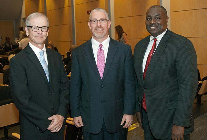 From left, Jon Walker, Tim Rogers and Roosevelt Weeks, director candidates, before the start of the Public Forum concerning the choice of a new OKC Metro Library System director, at the Ronald J. Norick Downtown Library. (Mark Hancock)