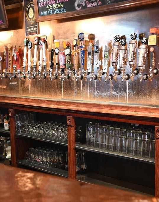 The many taps at Tapwerks in Bricktown, 6-18-2015. - MARK HANCOCK