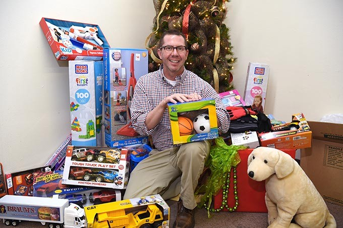 Kris Steele of TEEM organizes donations for the children of incarcerated parents. (Mark Hancock)