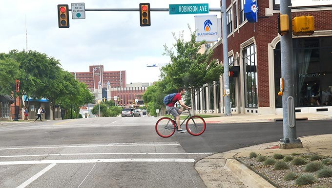 A bicyclist makes his way north on Robinson Avenue through MidTown recently.  mh