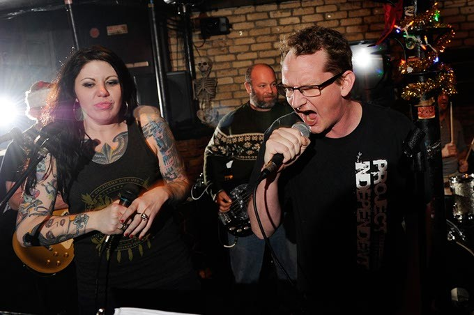 """Jolie Foster and Justin Void sing """"I Love Livin' in the City"""" by FEAR during Punk Rock Karaoke at the Drunken Fry in Oklahoma City, Tuesday, Dec. 17, 2014. - GARETT FISBECK"""