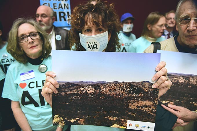 Shelly Campbell holds a photo of the Wichita Mountains with other Sierra Club members, at the news conference, Thursday, 1-15-15