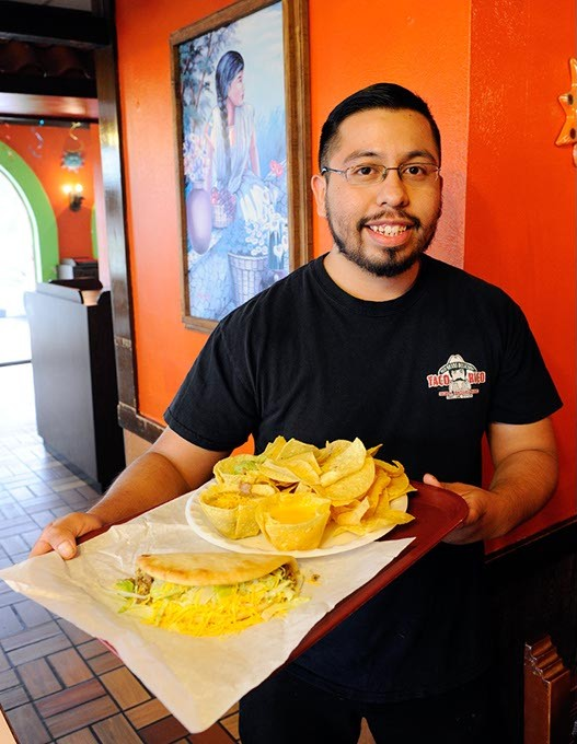 Elodio Santillan poses for a photo at Taco Rico in Oklahoma City, Wednesday, July 8, 2015. - GARETT FISBECK