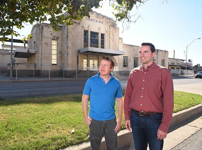From left, Jeff Bezdek, Bezdek + Associates, and MAPS Steetcar avisory board member, and Nathaniel Harding, MAPS Streetcar advisory chair, looking north up E.K Gaylord Boulivard to where a streetcar stop will be located, standing in front of the Santa Fe Station with fencing around it for it's renovation into a Transit Hub (according to recommended route framework Zeta on the City of OKC website), in Downtown OKC, 10-2-15. - MARK HANCOCK