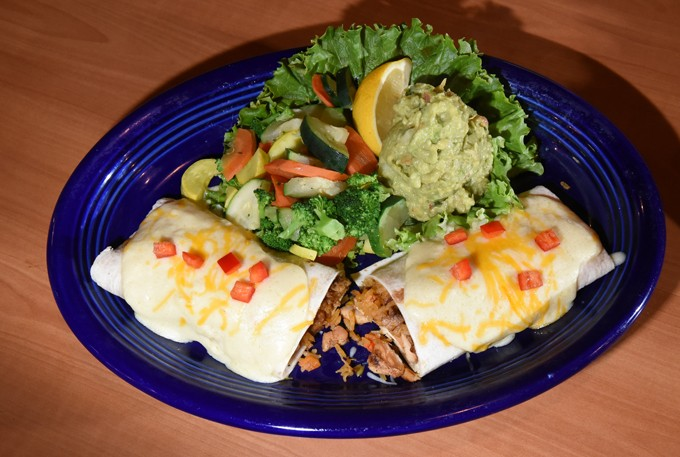 Chicken Burrito with quacamole and veggies, at Hidalgo's Cocina & Cantina in Edmond, Oklahoma, 1-19-16. - MARK HANCOCK