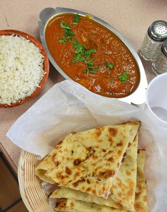 Tandoor restaurant is in the Checkers Truck Stop at 1901 E. Reno.  Photo is of Fish Curry with naan and rice.  mh